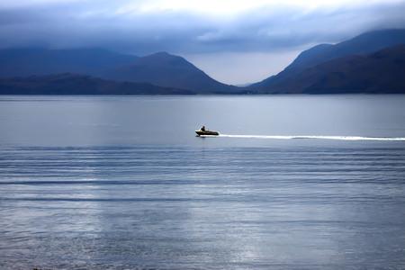 Motorboat at Loch Linnhe in Kentallen. Argyll, Lochaber, Scotland, UK