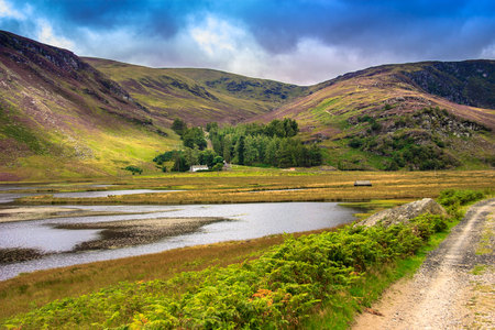 Hiking trail in Cairngorm National Park, south of the Grampian Mountains. Path around Loch Lee, Angus, Scotland, UK