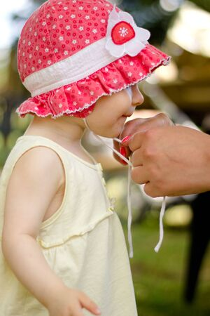 Portrait of cute little girl in red hat Stock Photo