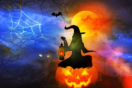 Halloween background. Witch with lantern against colorful background. Reklamní fotografie