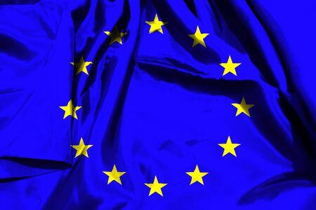European Union flag on textile cloth background.
