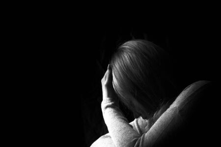 Black and white portrait of depressed woman. Stop violence against women or mental health issue concept.