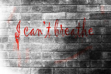I can't brethe. Text message painted on brick wall background. Slogan associated with the Black Lives Matter movement in the United States.