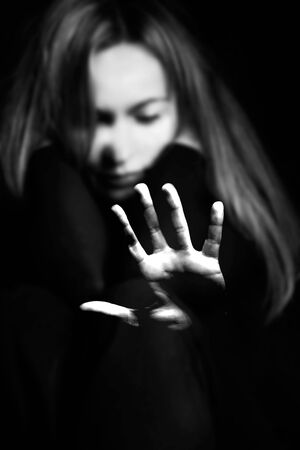 Woman showing gesture stop. Violence against women concept.