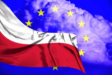 Polish flaf waving against European Union flag.