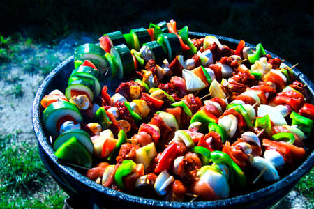 Food preparation. Grilled mixed meat with vegetables on barbecue grill.