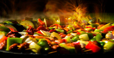 Cooking background. Skewers with meat and vegetables on the background of burning flames. Reklamní fotografie