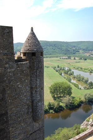 Dordogne river with a tower of Chateau de Beynac in the foreground photo