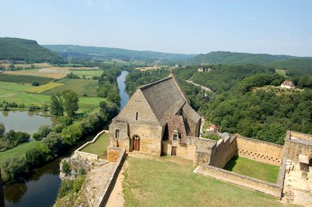 Dordogne river from the parapet of Chateau de Beynac with old chapel in foreground photo
