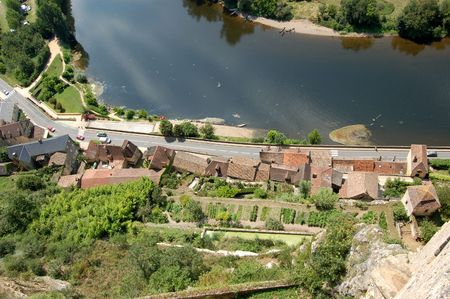 Beynac houses and gardens and the Dordogne river looking down from thewalls of Chateau de Beynac photo