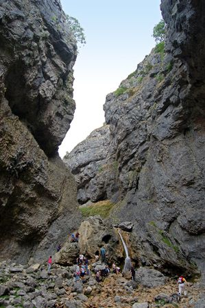 scrambling: Scrambling up the path inside Gordale Scar, Yorkshire
