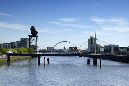 River Clyde at Pacific Quay, Glasgow with the Bells bridge in the foreground and the new Clyde arc behind it photo