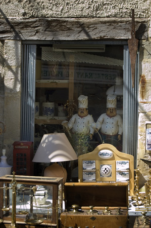 old items: Two pottery chefs among the items on sale in an old antique shop in Sault, Provence, France