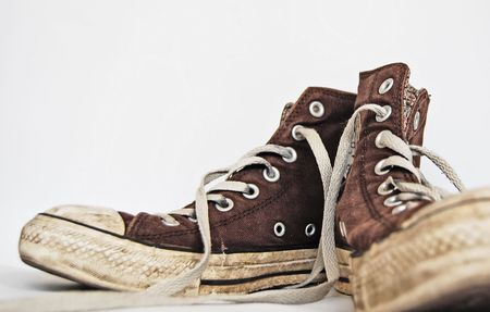 Old brown sneakers, trainers, shoes.