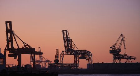Giant idle container cranes on a port Stock Photo