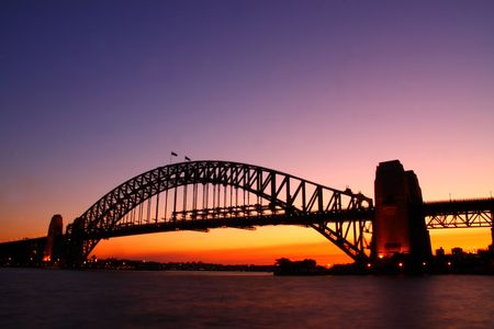 Sydney Harbour Bridge with a sunset in the background
