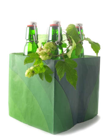 Box with green Beer bottles isolated on white photo