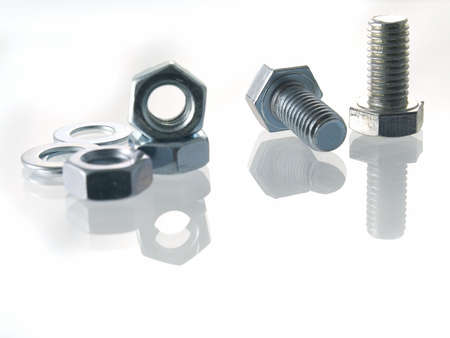 hardened: screws and nuts on a white background