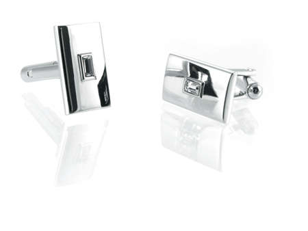 cuff link: silver cuff link isolated on white background Stock Photo