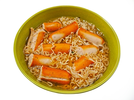 Bowl of noodles and hot dog isolated on white background top view