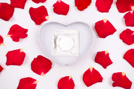 Dear love roses special occasions along with condoms isolated background Stock Photo