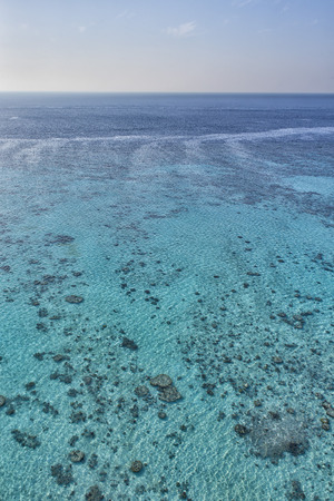 reef aerial view with turquoise clear water photo
