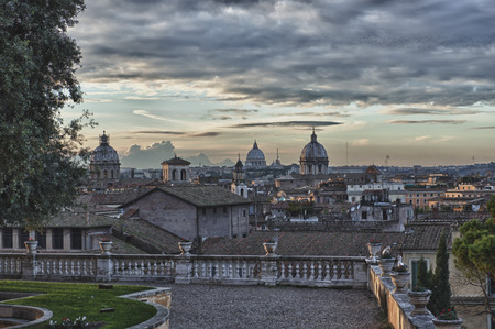 Rome sunset view with saint peter vatican dome photo