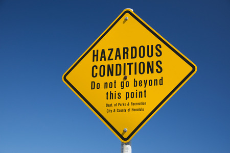 hazardous conditions danger sign in hawaii on the shore photo