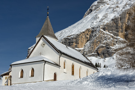 mountain church in winter on sunny day photo