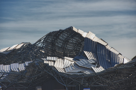 rebuild: Destroyed metallic roof after hurricane Stock Photo