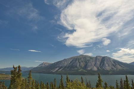 British Columbia white pass panorama in cloudy sky background photo