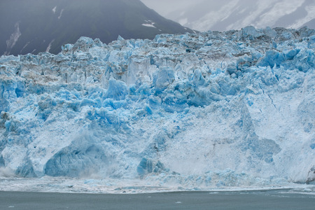 A Glacier while melting in Alaska photo