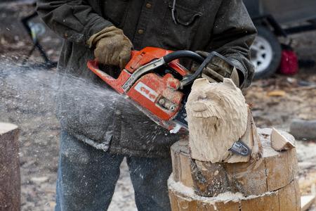 Electric Saw bear head sculpture in Alaska photo