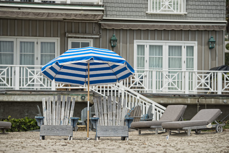 zuma: sitting chairs on california zuma sandy beach Stock Photo