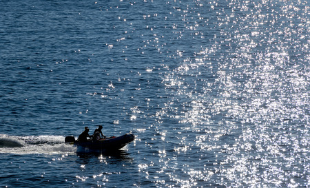 Inflatable zodiac on the deep blue sea photo