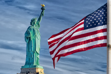 Usa American flag stars and stripes on statue of liberty blue sky background photo