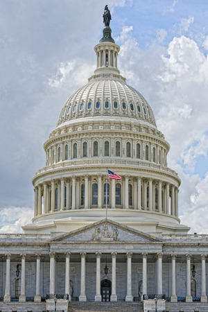 Washington DC Capitol dome detail with waving american flag Imagens - 31595071