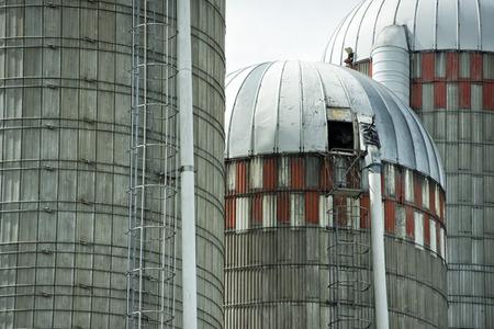 grain wheat metallic silo on cloudy sky background photo
