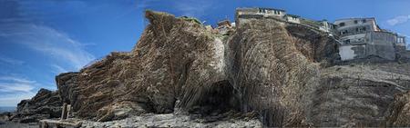 landslip: Metallic grid on rocks to prevent village landslip  Stock Photo