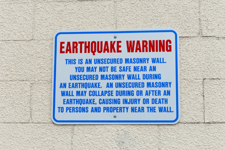 earthquake crack: Earthquake Warning Wall Sign in Anchorage, Alaska USA Stock Photo