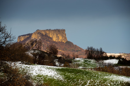 The flat stone mountain in Italy at sunset in winter time photo