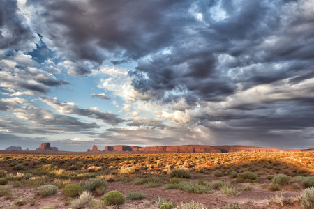 monument valley view: Monument Valley view at sunset with wonderful cloudy sky and lights on mittens