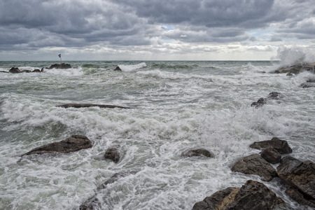 Sea Storm in a cloudy sky background photo