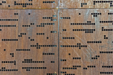 morse code: morse code rusty iron rugged wall Stock Photo