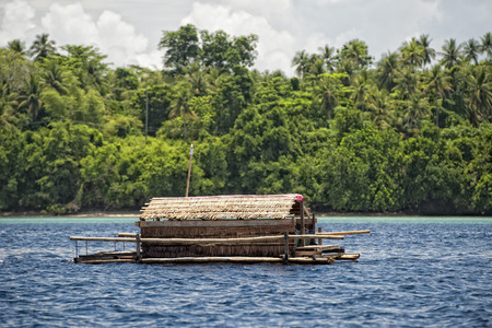fishing platform in the middle of the sea in indonesia Imagens - 34178431
