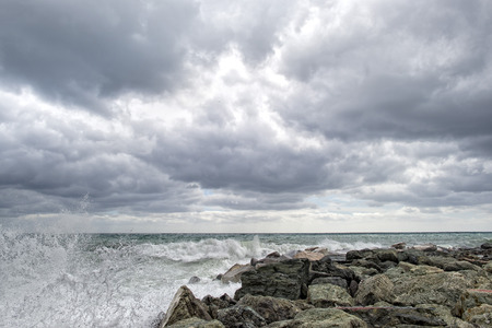 tempest: sea in tempest on rocks with splashes