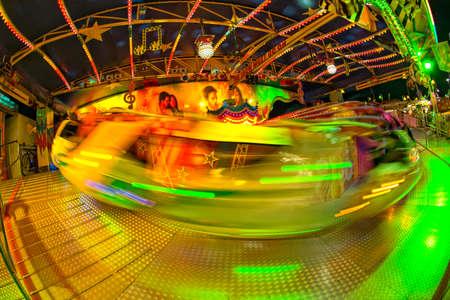 Fun Fair Carnival Luna Park moving lights on night background