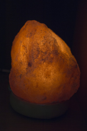 salt lamp: salt lamp on black background Stock Photo