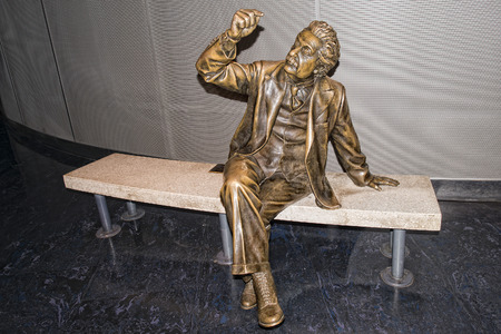 albert: albert einstein sitting on a bench copper statue