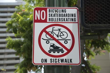 rollerskating: no rollerskating bicycling skateboarding sign in hawaii Stock Photo